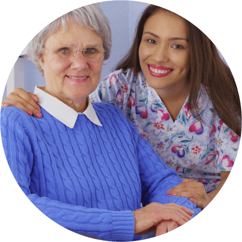 A caregiver and her patient smiling