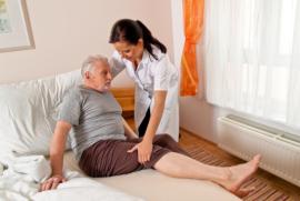 Caregiver helping Injured Elderly
